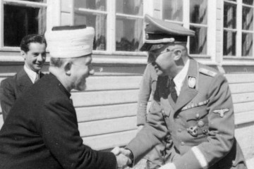 President home the grand mufti with the leader of the ss heinrich himmler.