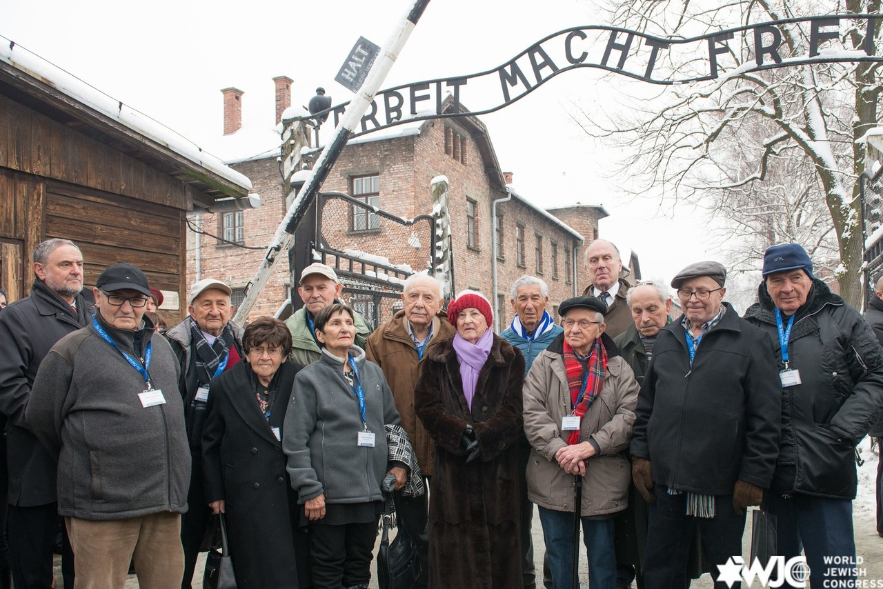 WJC President Ronald S. Lauder (back right) and WJC CEO Robert Singer (back left), stand together with survivors of Auschwitz, as part of the 70th anniversary commemorations. 26 January 2015. (c) Shahar Azran