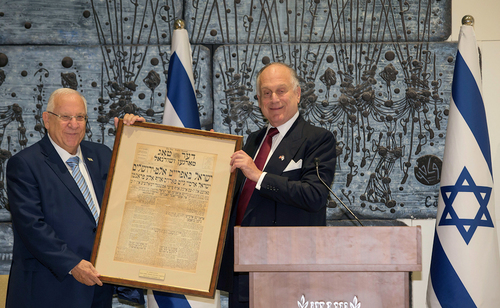 President Reuven Rivlin (l) receives the front page of a Yiddish newspaper from June 1967, when Israel liberated the Old City of Jerusalem (credit:Eli Dasa)